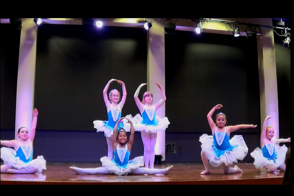 Girl dancers in blue and white dresses